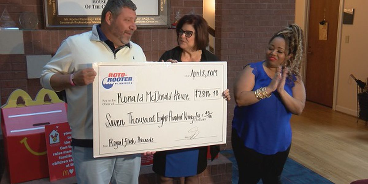 Roto-Rooter Plumbers presents check to Ronald McDonald House