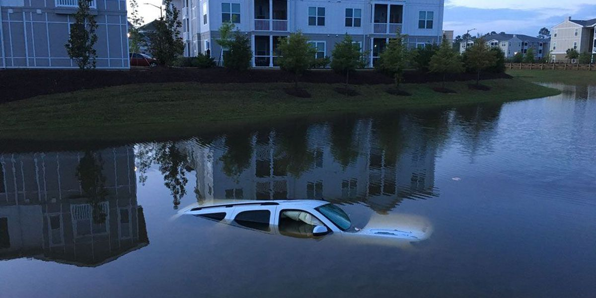 SUV hydroplanes off road, ends up submerged in Pooler pond