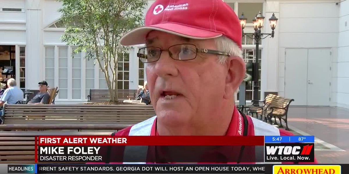 Red Cross volunteer helping with relief efforts