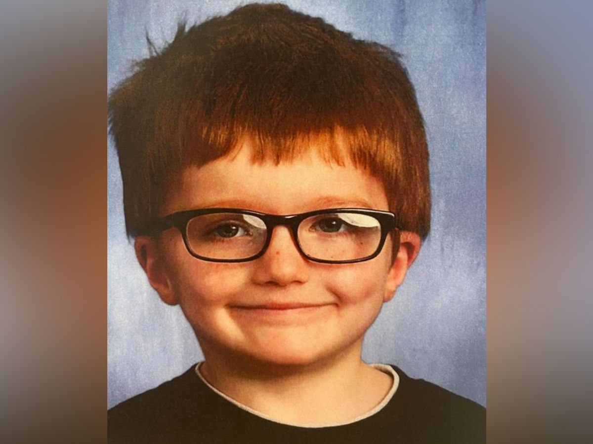 Police: Ohio boy killed, put in river; mother and her boyfriend charged
