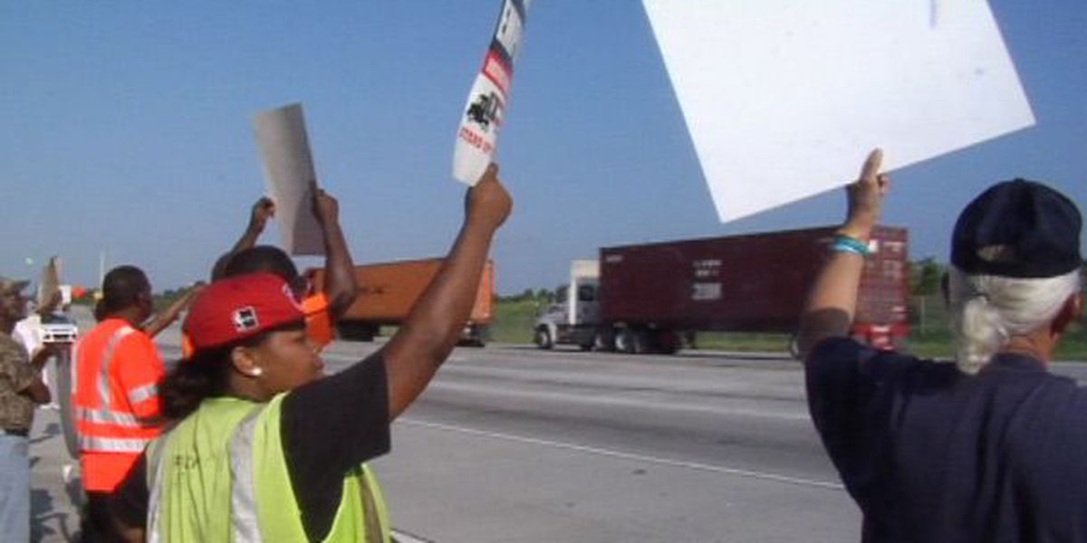 Truck drivers rally over classification