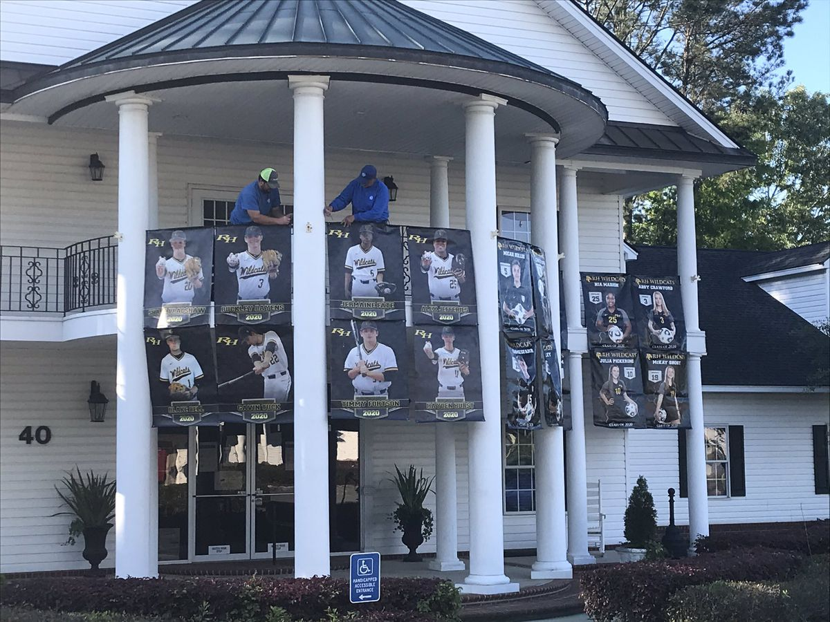 Richmond Hill senior banners being hung at city hall