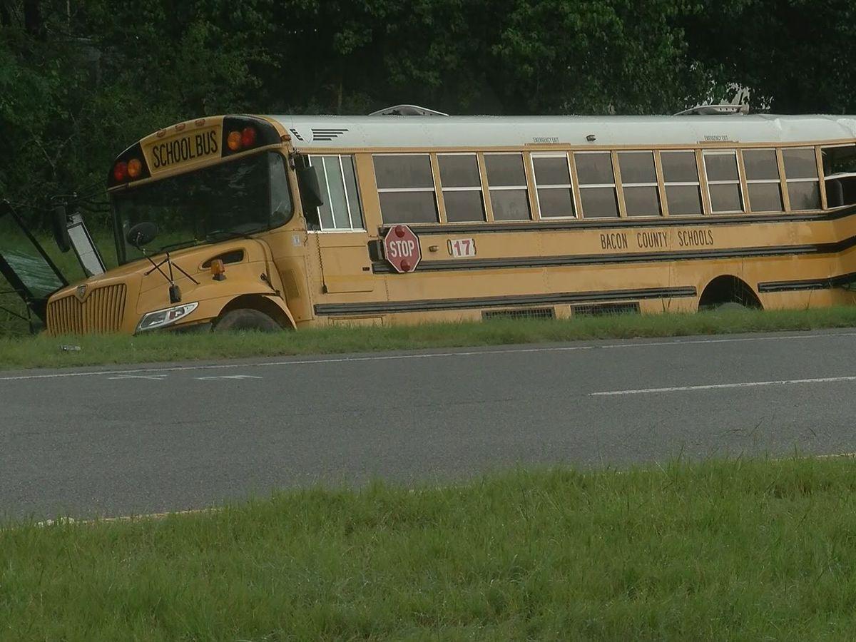 Truck driver killed, students injured in crash involving school bus in Alma, Ga.