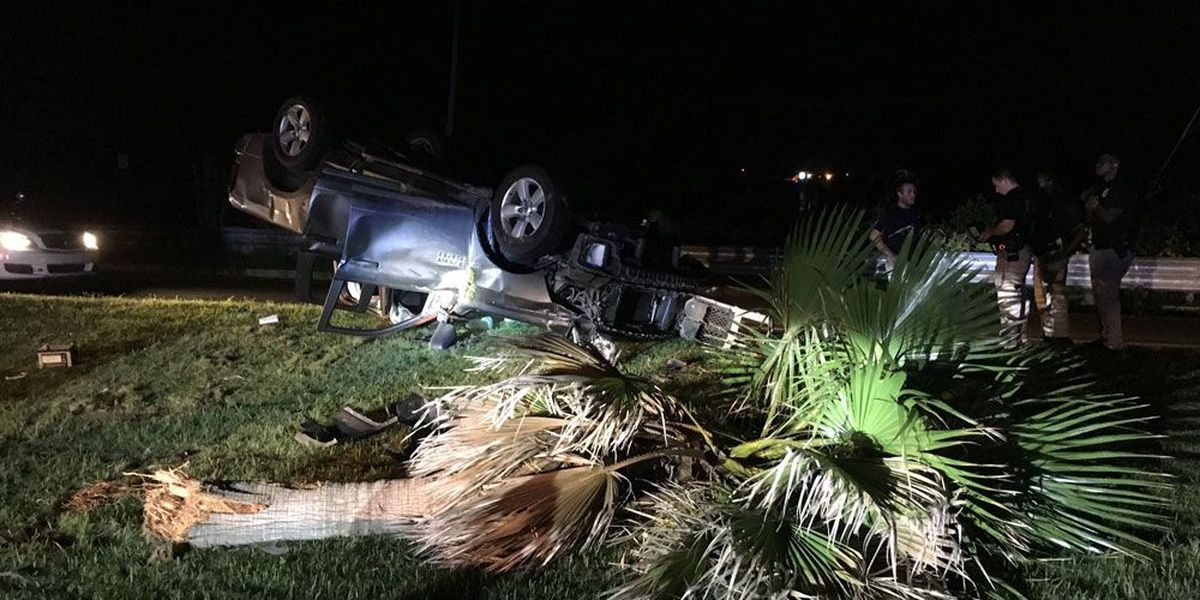 Driver escapes injury after truck overturns near Talmadge Bridge