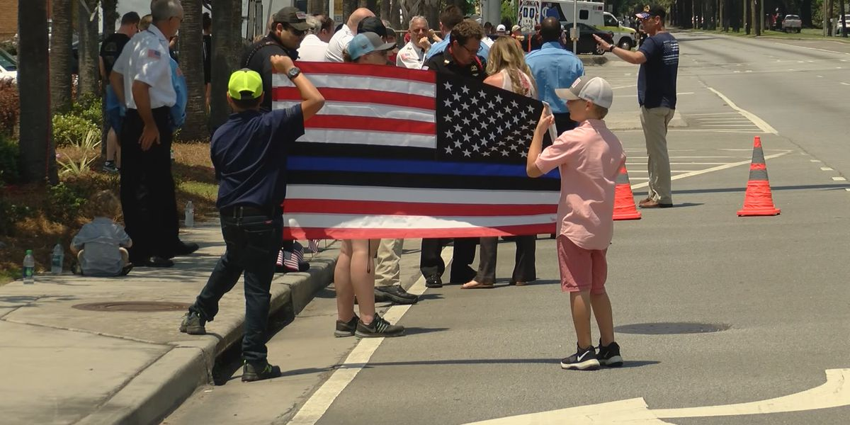 Supporters line fallen officer's funeral procession route