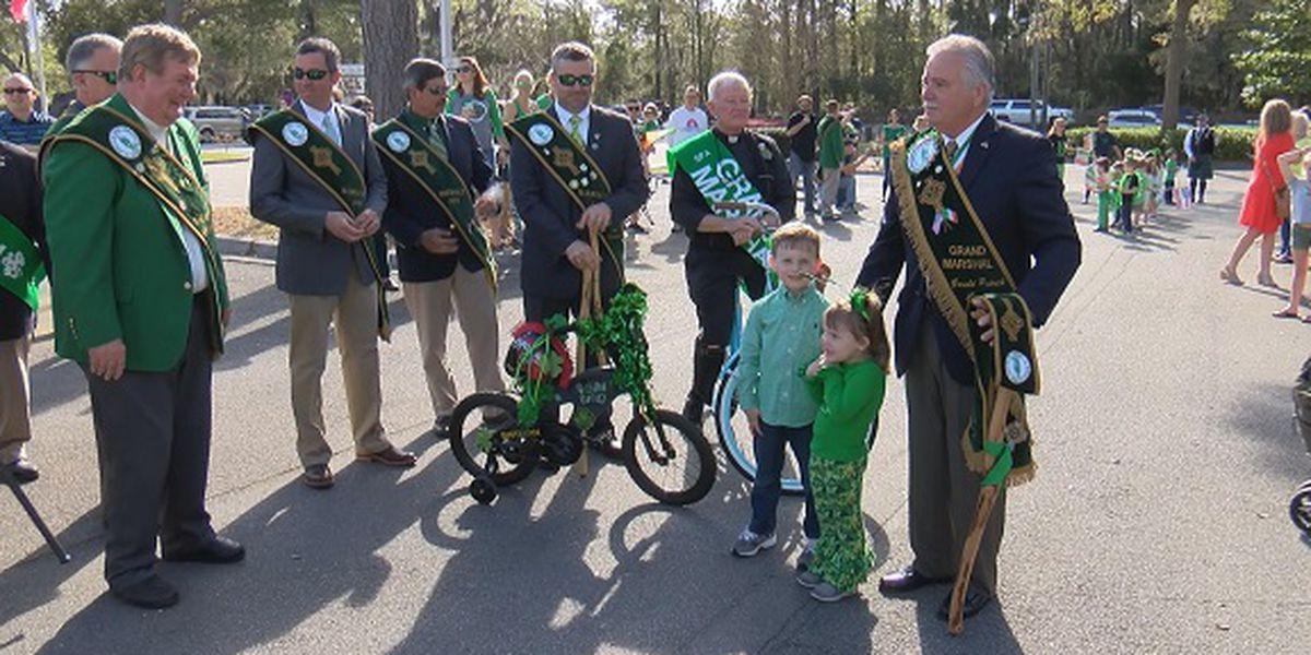 Grand Marshal leads mini bike parade at St. Peter the Apostle Catholic School
