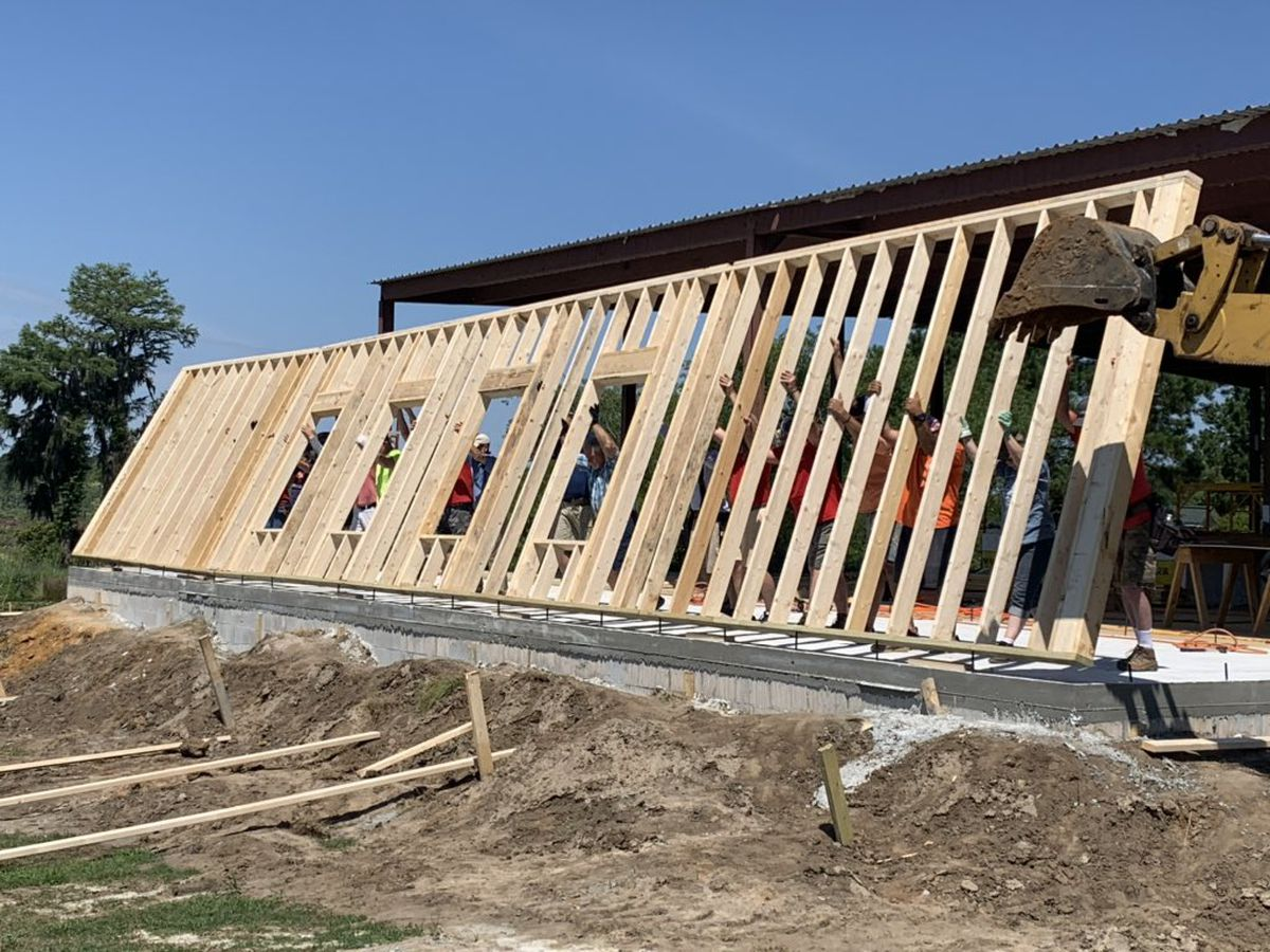 Volunteers helping build structure in Statesboro for Seventh Mile Farm
