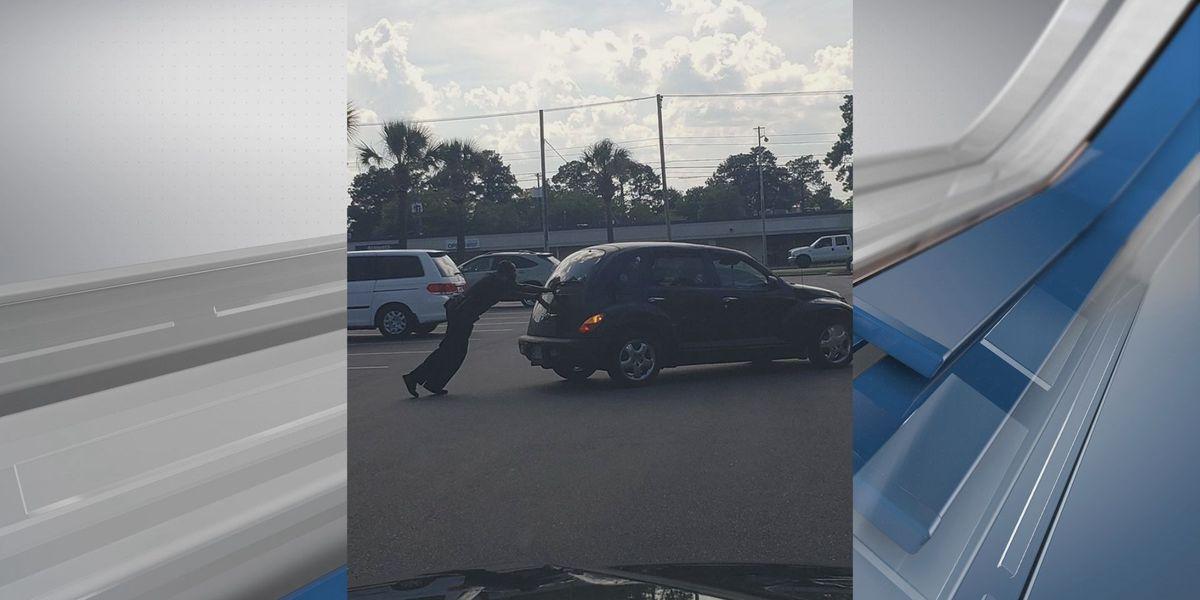 Savannah officer photographed helping push car that had broken down