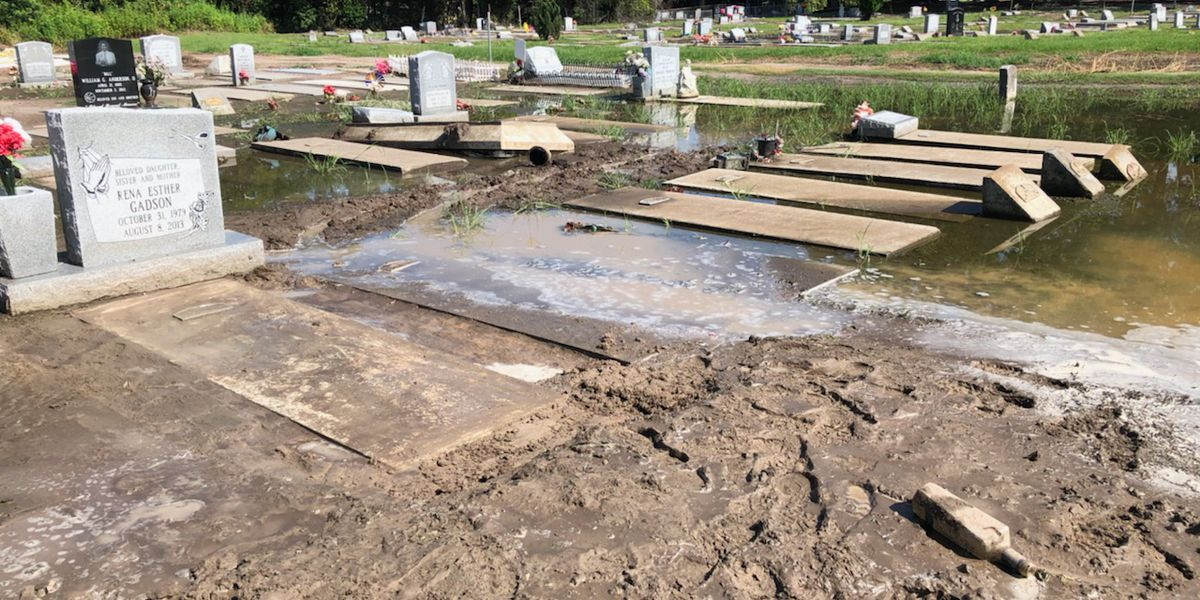 Families left cleaning up graves after flooding at Woodville Cemetery