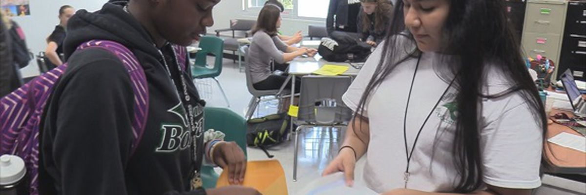 Bluffton High School students holding 'Bills for the Bahamas' fundraiser
