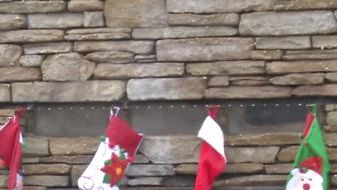 Retired firefighter hangs stockings over fireplace, the only part of his Paradise, CA, home left standing