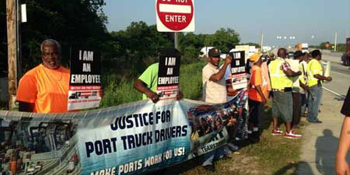 Truck drivers rally at ports for better pay