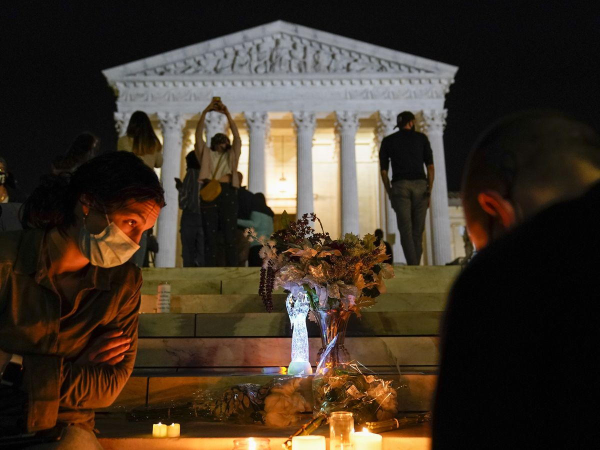 Flowers, homemade signs by high court in Ginsburg tribute