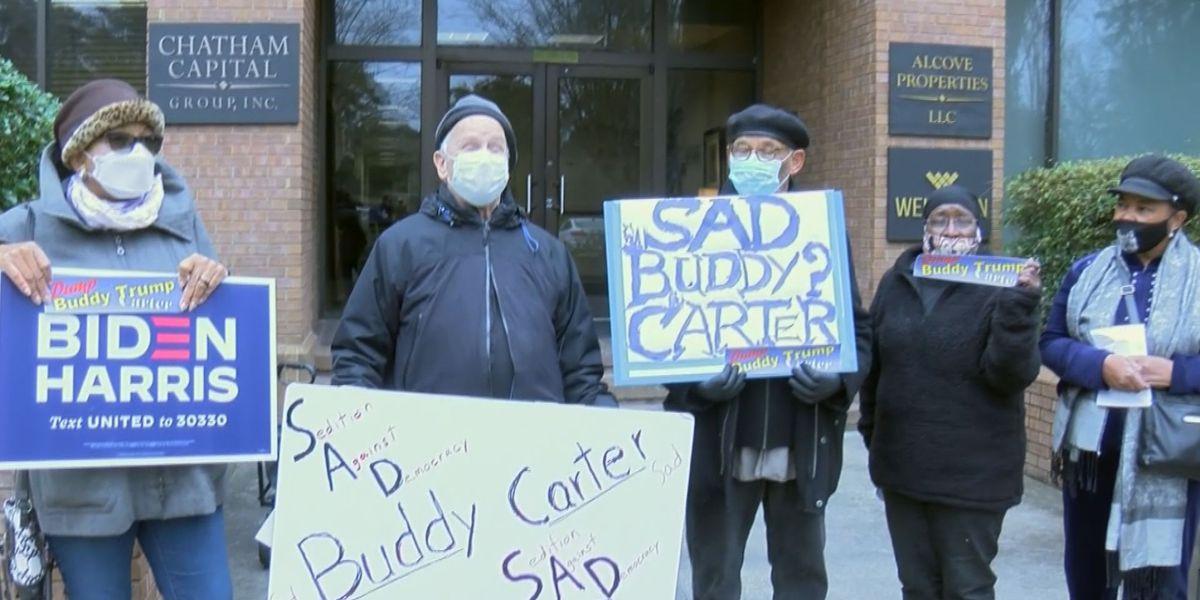 Group protests at Rep. Buddy Carter's Savannah office