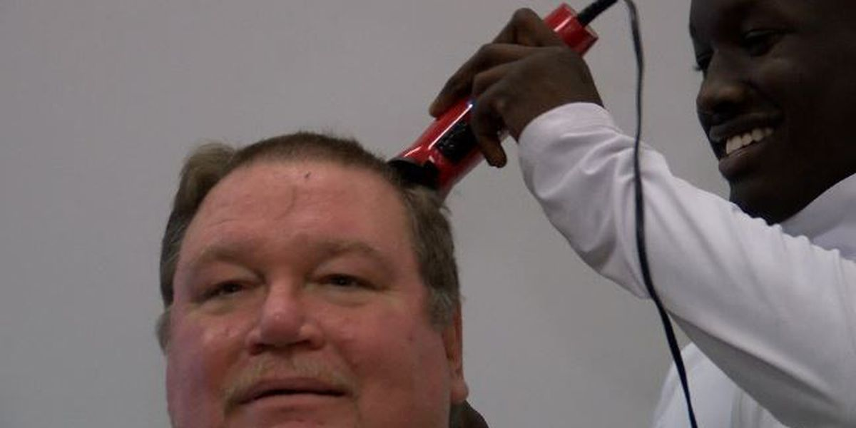 Wildcat wrestling coaches honor bet, shave heads