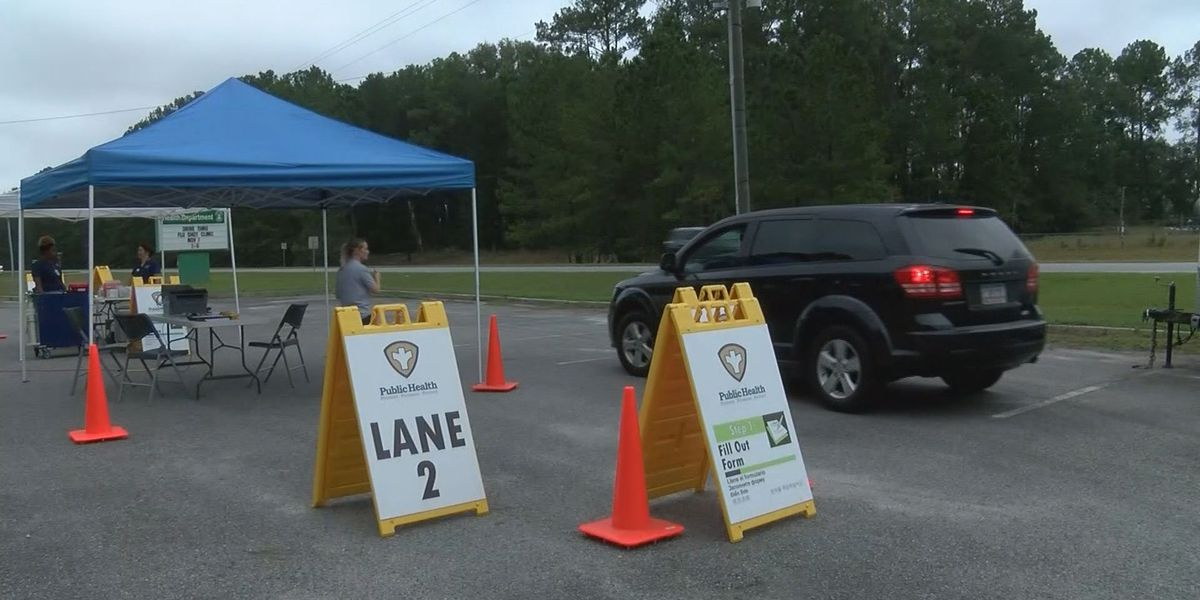 Drive-thru flu shot clinic provides special practice for health workers