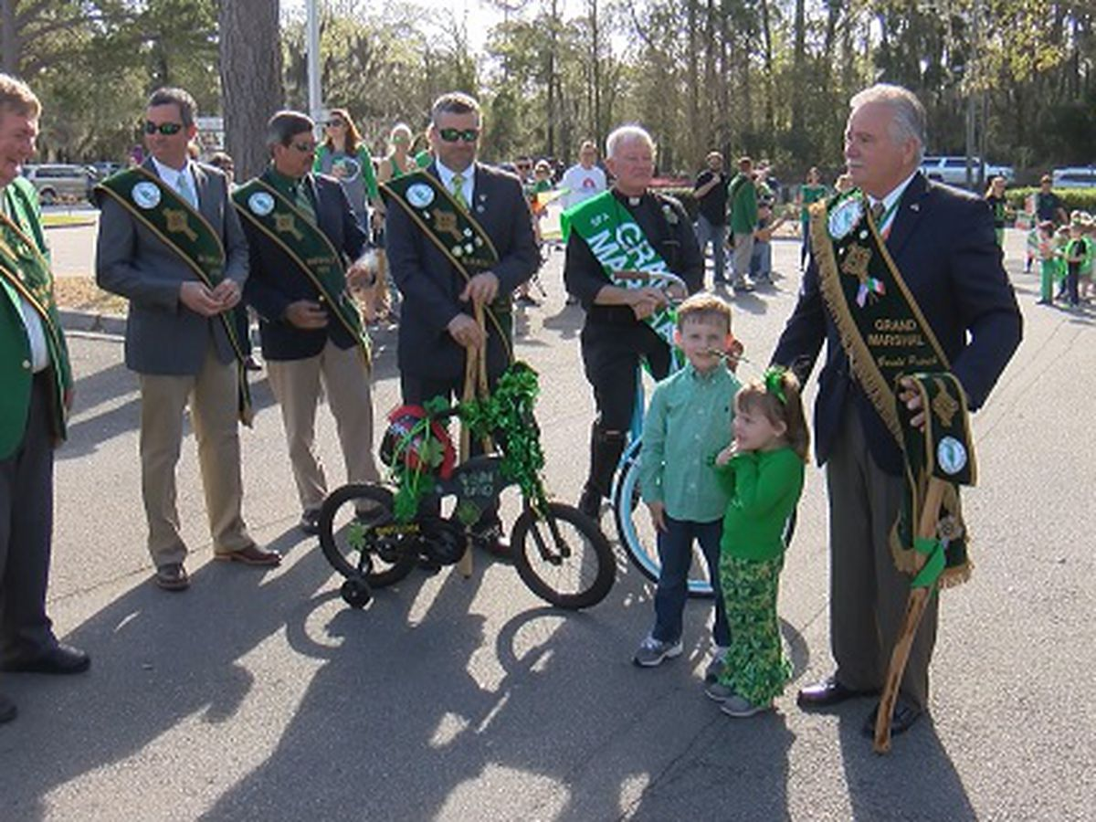 Grand Marshal leads mini bike parade at St. Peter the Apostle Catholic School