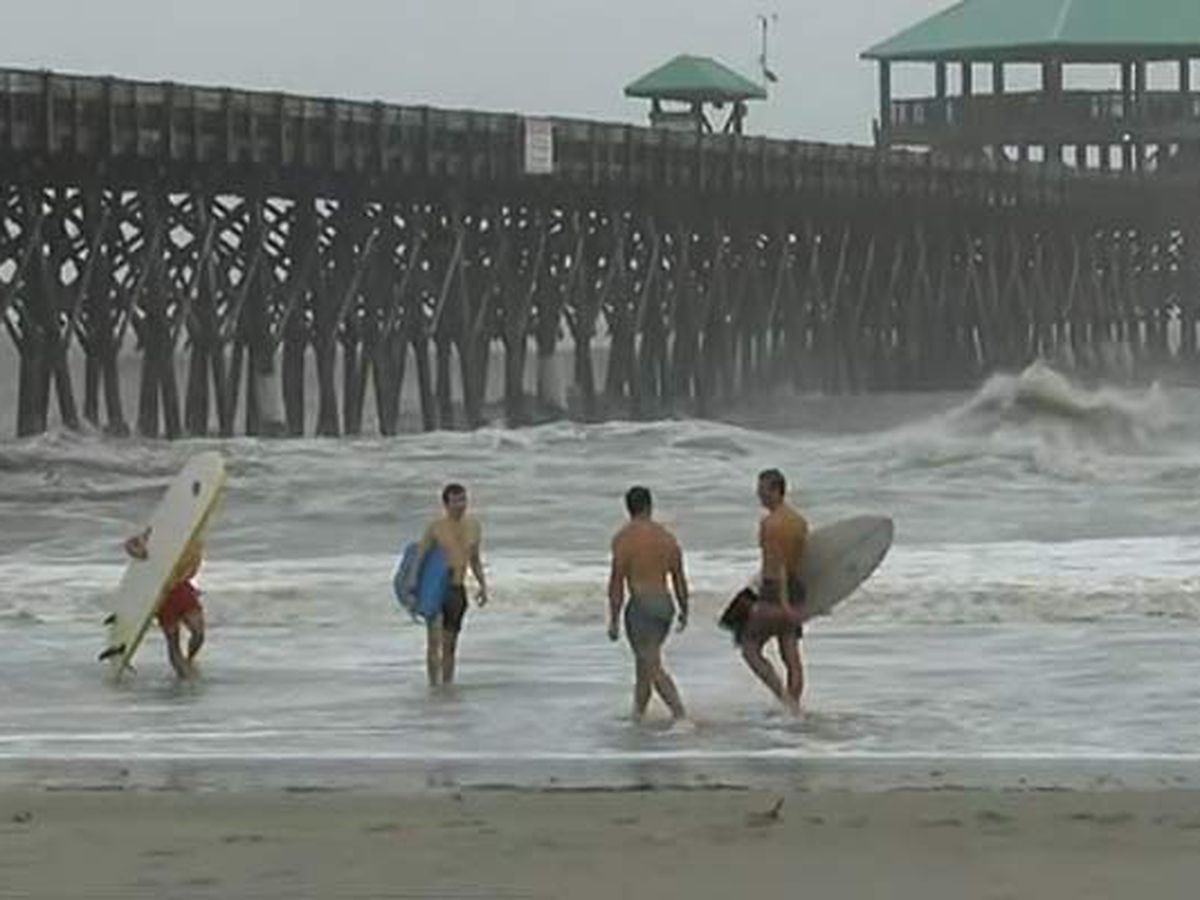 Surfers brave the waves Isaias churns up at Folly Beach