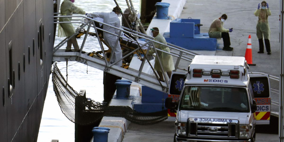Florida finally takes passengers of coronavirus-stricken cruise ship, some on stretchers
