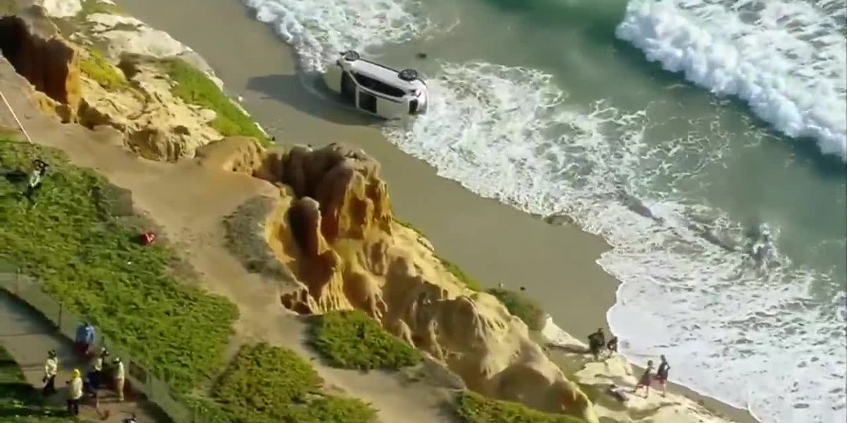 Man rescued after driving SUV off cliff