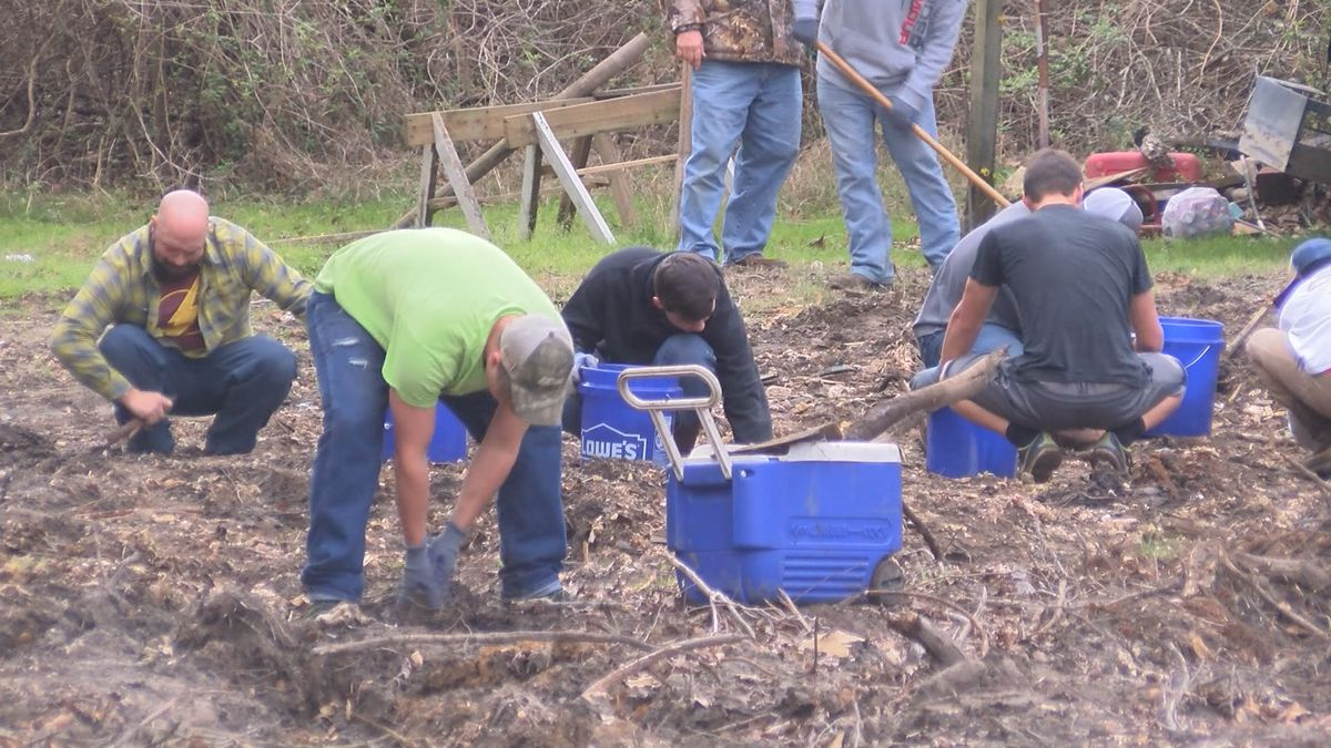Boy's home helps to clear remains of Tatnall Co. family's house after Hurricane Michael