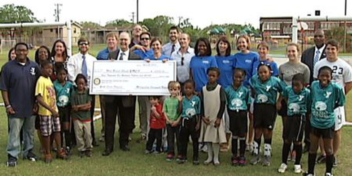 West Broad St. YMCA receives check from Metropolitan Savannah Rotary