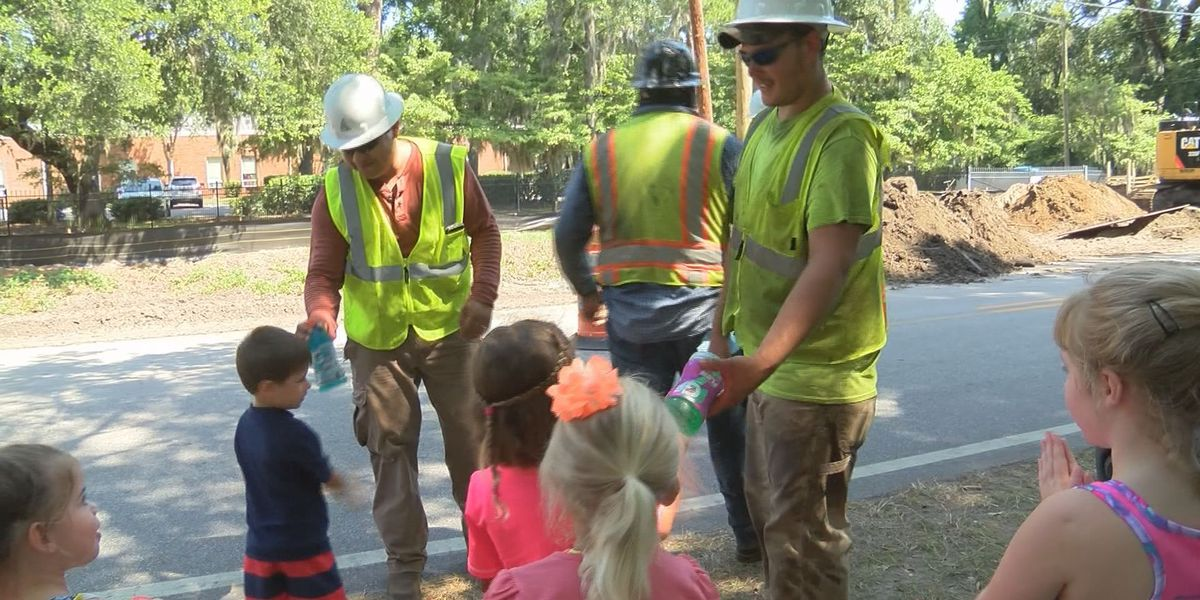 Children bring cold Gatorade to construction crews working on Concord Road