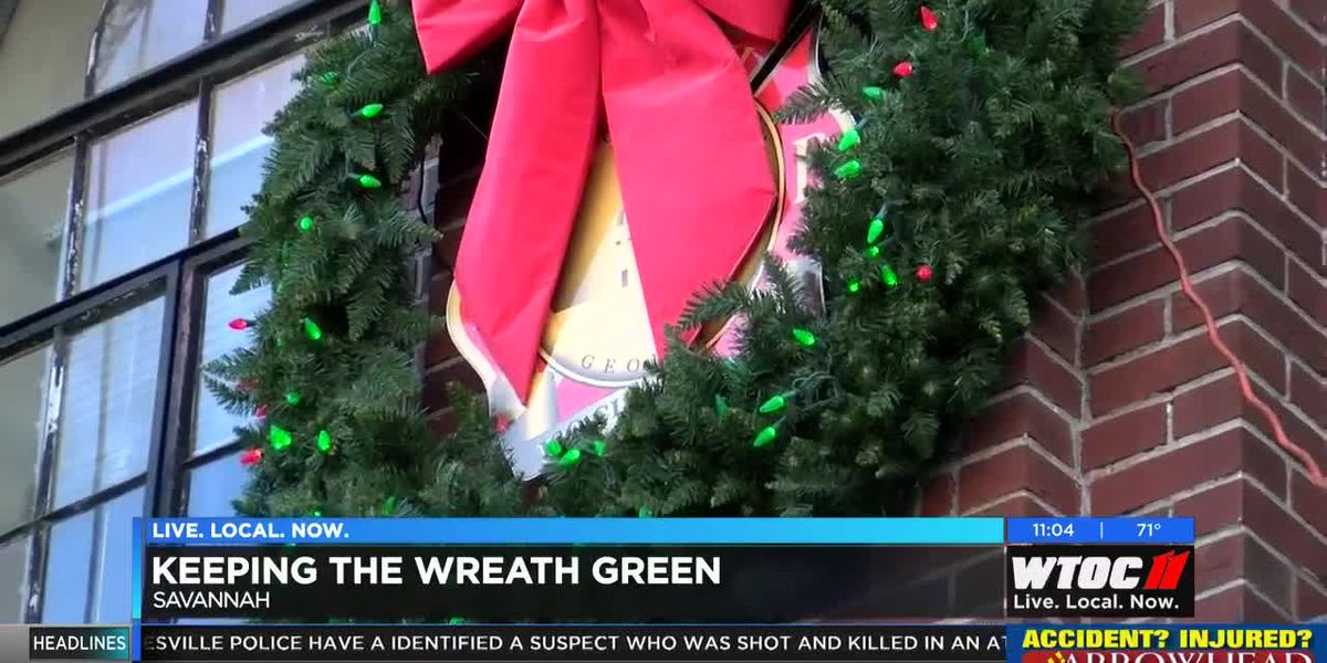 Savannah Fire adds red bulbs to holiday wreath
