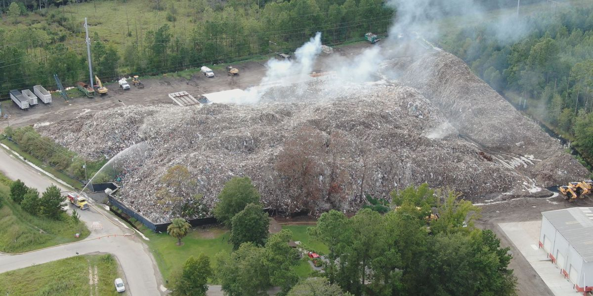 Owner of burning trash site agrees to close facility