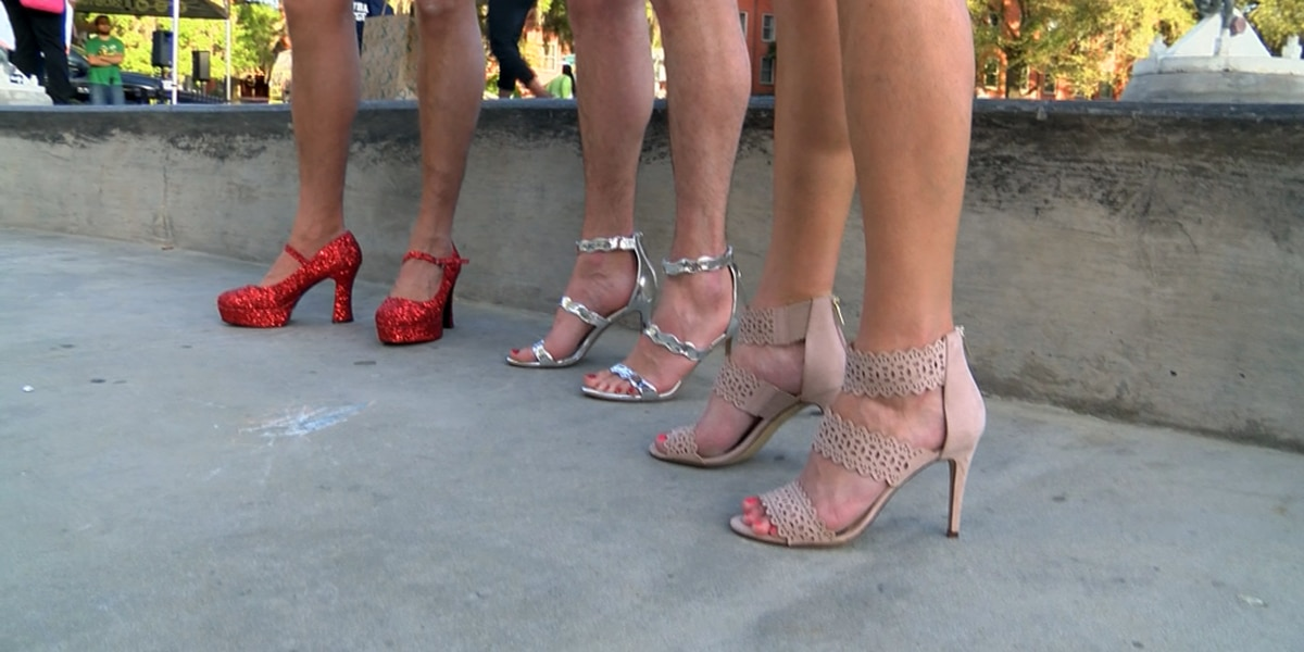 Dozens of men 'Walk a Mile in Her Shoes' for a good cause