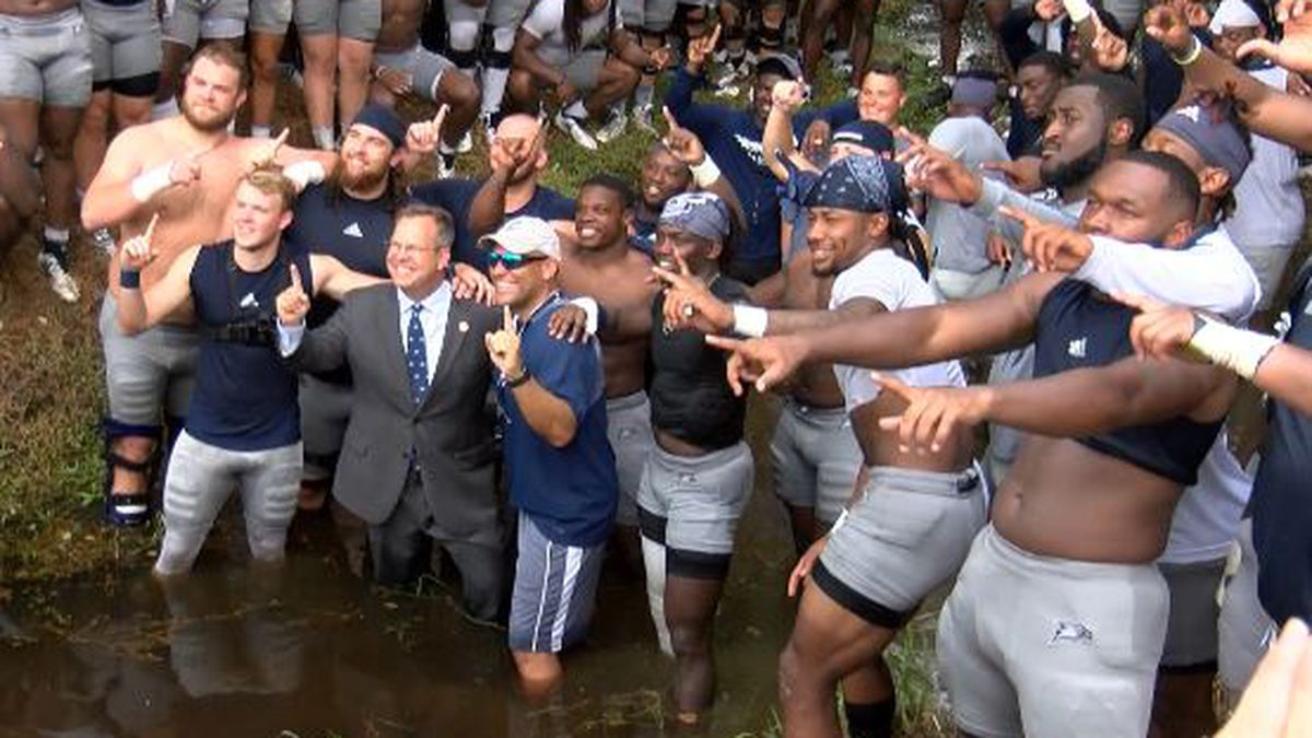Eagles, new university president take part in traditional baptisms