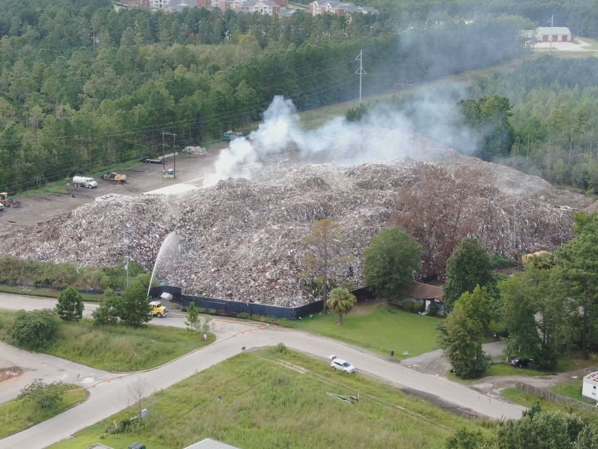 DHEC takes over burning trash pile on Able Contracting site