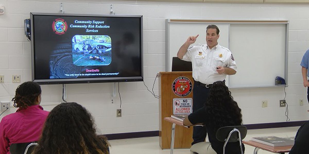 Burton firefighters, crash victim visit high school to promote seat belt safety