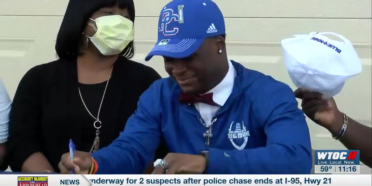 Bethesda football standout holds socially distanced signing