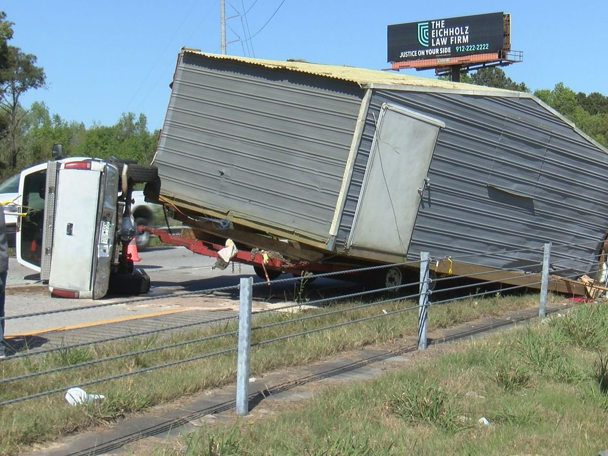 Overturned vehicle that was carrying small building causing traffic delays on I-16