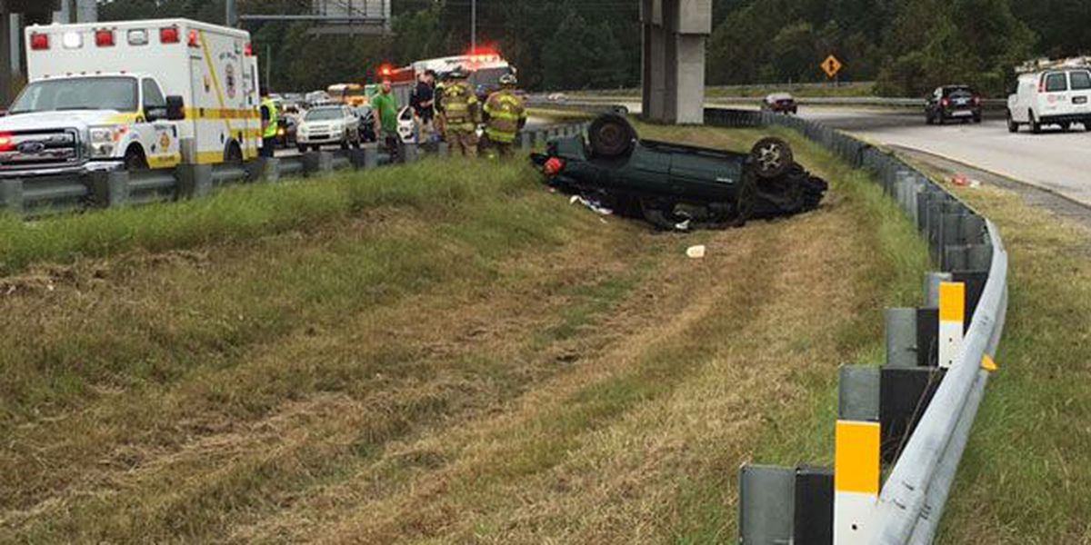 Overturned SUV in median of I-516 has one northbound lane blocked at the Veterans Parkway overpass