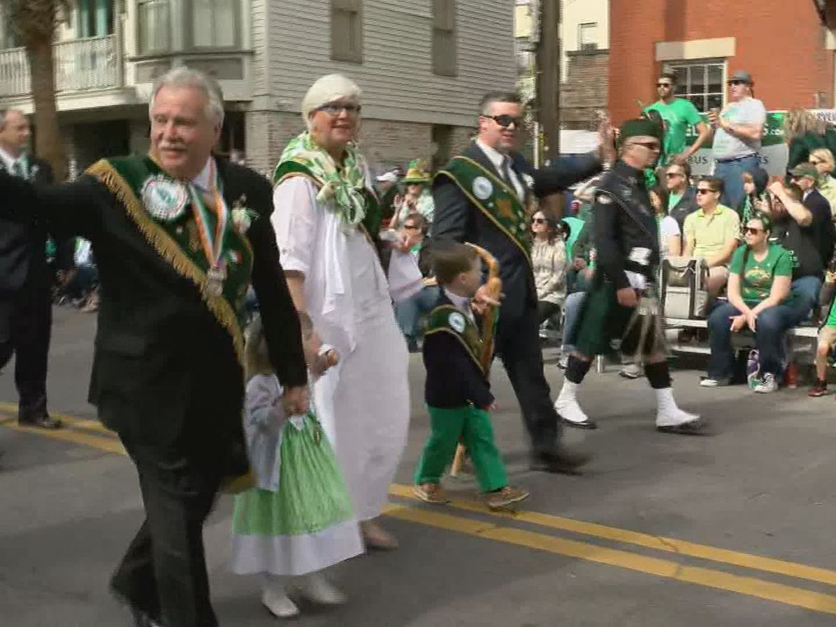 2019 Grand Marshal receives blessing surrounded by family