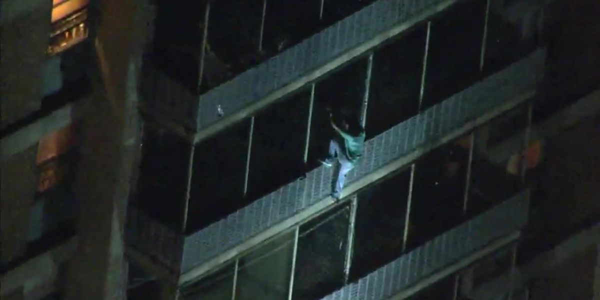 Man climbs down high-rise building to escape fire