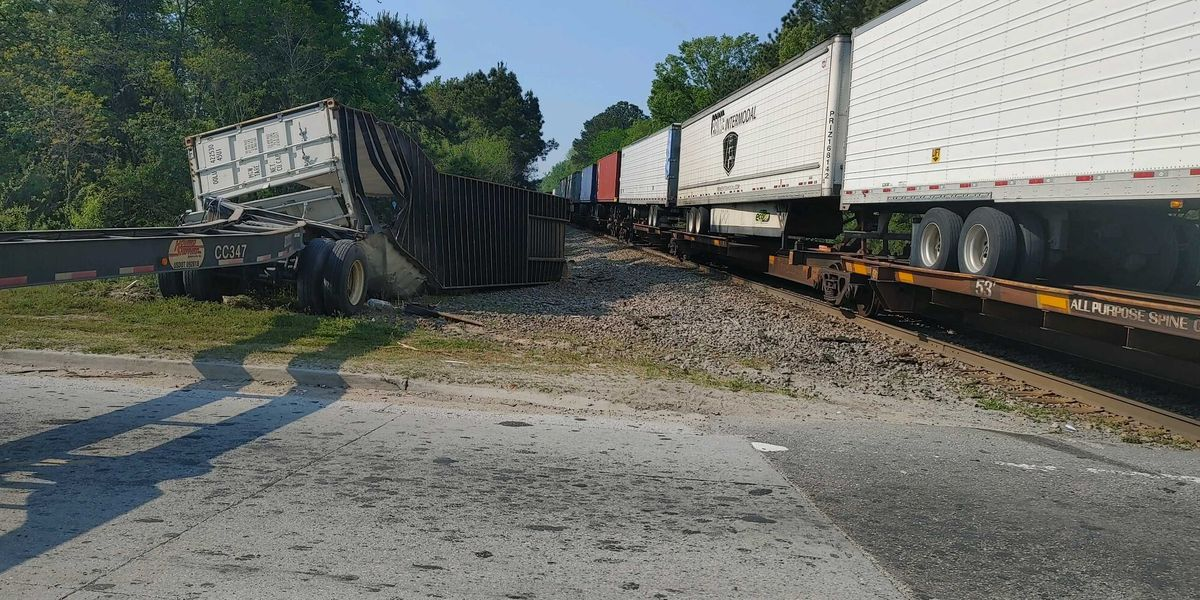 No injuries reported after train hits semi at Dean Forest, Hwy 21