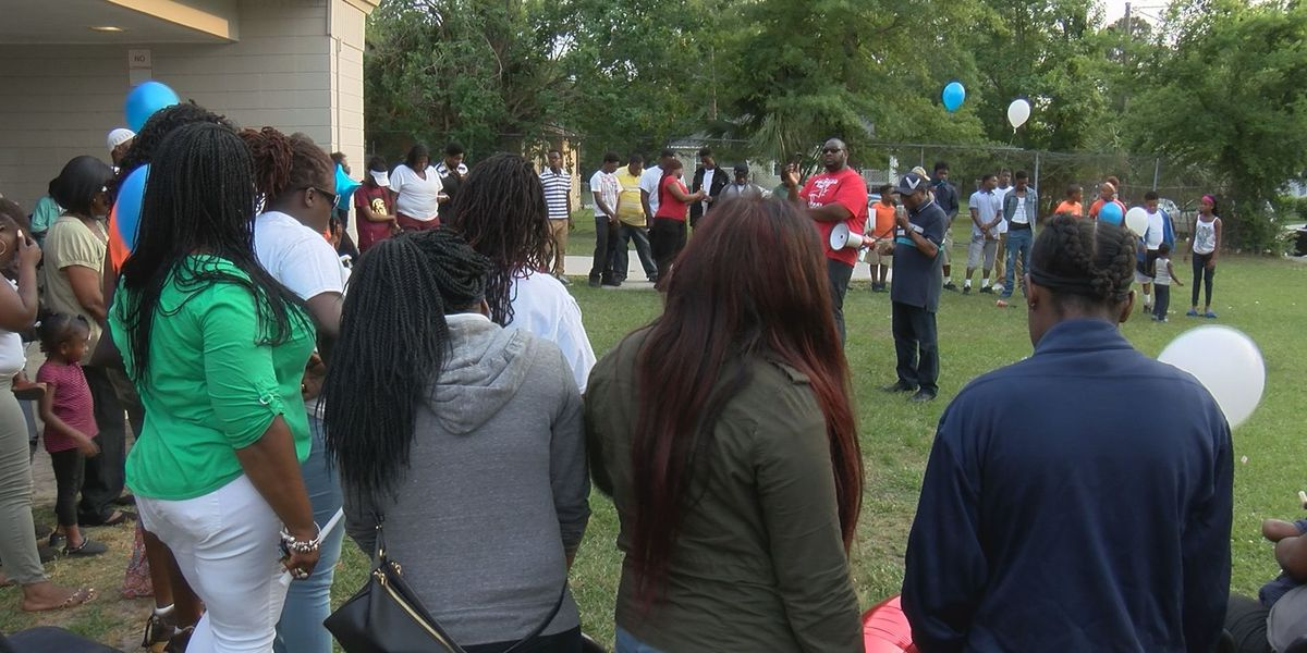 Friends and family remember triple homicide victim at vigil