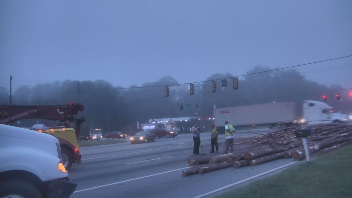 Dean Forest Road, Hwy 80 intersection open after logs spill from overturned truck